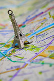 Paris name at a map with red Eiffel tower miniature. Travel Destination Paris Stock Images