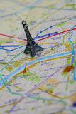 Paris name at a map with red Eiffel tower miniature. Travel Destination Paris Royalty Free Stock Images