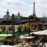 Paris, near the Seine. France. Fly-boats, Alexandre III bridge and the Eiffel Tower. At the Port des Champs-Elysées Stock Photography