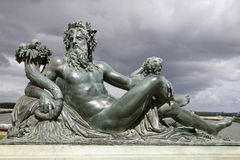Paris - Neptune statue form Versailes Stock Images