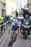 Paris- Nice Cycling Race Action. Houilles, France- March 3rd 2013: A cyclist from FDJ team, riding during the prologue of the cycling road race Paris- Nice 2013 Royalty Free Stock Photography