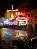 Paris by night. Moulin Rouge at rainy night. People queuing for tickets Royalty Free Stock Photography