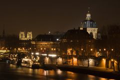Paris by night. Night view of the Seine river, Notre-Dame cathedral and the French Institute - Paris, France Stock Image