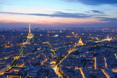 Paris by night. Paris Skyline by night with illuminated Eiffel tower, Invalides, and arc de Triomphe Stock Images