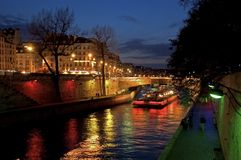 Paris by night. The seine river by night in Paris with colored light Stock Images