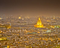 Paris at Night. The city of Paris at night, with the Invalides glowing golden and Notre Dame Cathedral in the background Royalty Free Stock Image