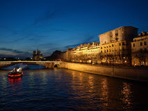 Paris at night. Highlighted from boat houses on Seine, Paris, France Royalty Free Stock Photography