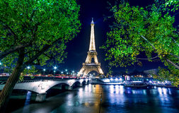 Paris night cityscape.  Eiffel tower light show on Seine river Stock Photo