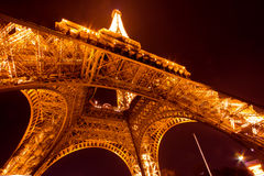 Paris by night: Eiffel tower. Eiffel tower of Paris illuminated just before the night Stock Photos