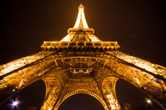 Paris by night: Eiffel tower. Eiffel tower of Paris illuminated just before the night Royalty Free Stock Photography