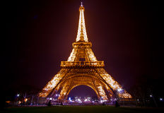 Paris by night: Eiffel tower. Eiffel tower of Paris illuminated just before the night Royalty Free Stock Image