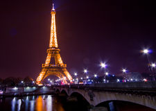 Paris by night: Eiffel tower. Eiffel tower of Paris illuminated just before the night Royalty Free Stock Photo