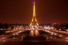 Paris by night: Eiffel tower. Eiffel tower of Paris illuminated just before the night Stock Image