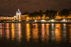 Paris by night. Paris, by night on the Seine in front of the Pont des Arts stock images