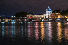 Paris by night. Paris, by night on the Seine in front of the Pont des Arts stock photos