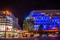Paris at night. Shopping mall Galeries Lafayette outdoors, night time. Paris, France Royalty Free Stock Photos