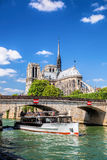 Paris, Notre Dame cathedral with boat on Seine, France Royalty Free Stock Photos
