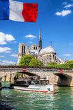 Paris, Notre Dame cathedral with boat on Seine, France Royalty Free Stock Image