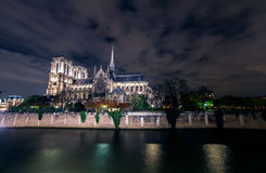 Paris Notre Dame cathedral by night from Seine river. Paris Notre Dame cathedral by night view from bridge on Seine river stock image