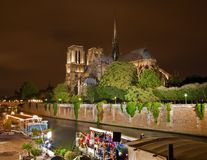 Paris - Notre Dame cathedral and the riverside at night.  Stock Image