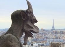 Paris Notre Dame Goat Gargoyle with Eiffel Tower Stock Image