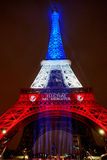 PARIS - NOVEMBER 16: Eiffel tower illuminated with colors of the French national flag on the day of mourning on November 16, 2015 Stock Photo