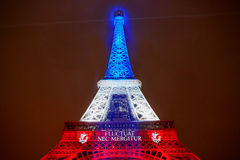 PARIS - NOVEMBER 16: Eiffel tower illuminated with colors of the French national flag on the day of mourning on November 16, 2015 Royalty Free Stock Images