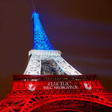 PARIS - NOVEMBER 16: Eiffel tower illuminated with colors of the French national flag on the day of mourning on November 16, 2015 Stock Image