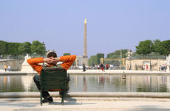 Paris Obelisk. Paris. Man sitting in the Garden of the Tuilleries, looking at the obelisk on the Place de la Concorde stock images