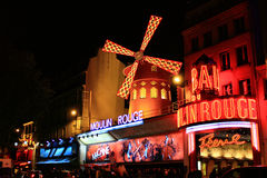 PARIS - OCT 29: The Moulin Rouge by night Stock Images