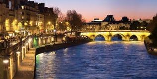 Paris, panorama along Seine river towards illuminated Pont Neuf Royalty Free Stock Photos