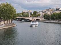 Paris passenger ferry rounds Ile Saint Louis on the Seine Royalty Free Stock Images