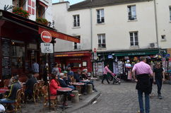 Paris, people relax outdors. In Paris in Montmartre sunny summer day people relax in cafes Stock Images