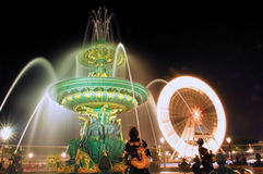 Paris. Place de la Concorde: Fountain at nigh. Paris. Place de la Concorde: Monuments of Paris Fountain at night and the big wheel royalty free stock photography