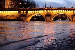 Paris Pont Neuf Bridge Seine river floods. Under the Bridge Pont Neuf New Bridge, the Seine river water level rises above the ordinary level in Paris, France royalty free stock photo