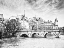 Paris. Pont Neuf in central Paris, France. The Pont Neuf is the oldest standing bridge across the river Seine in Paris. Black and white. noise added stock image