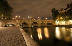 Paris - Ponte nuef riverside in night Stock Photo