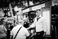 Paris Restaurant, France. French waiters going about their daily business in a Paris Restaurant. Place Du Tertre, Paris, France Stock Photography