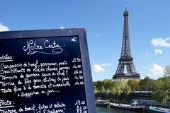 Paris restaurant menu board close up, Eiffel Tower and river seine boats Stock Photos