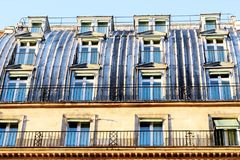 Paris roof of zinc with a large number of windows. A typical parisian building zinc roof with a large number of windows near the street of Rivoli, Paris, France stock photography