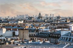 Paris roofs under a shiny sunset Royalty Free Stock Photos