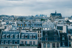 Paris rooftops aerial cityscape on cloudy day. Rooftops in Paris on moody day stock photo