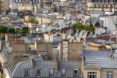 Paris rooftops in Summer with roof gardens and Mansard roofs. France Royalty Free Stock Photography