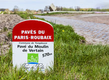 Paris Roubaix- Milestone. Templeuve,France- April 5, 2014:Image of a specific milestone indicating the start of a cobbelstone road included in the route of Paris Stock Photos