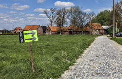 Paris Roubaix- Route Indicators. Templeuve,France- April 5, 2014:Route indicators are placed on the side of the cobblestone road near the Moulin de Vertain few Royalty Free Stock Image
