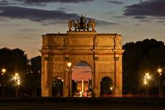 Paris's Arches at Night. View of L'Arc de Triomphe and the Place de la Concorde from L'Arc de triomphe du Carrousel Stock Images