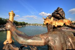 Paris Seine Cityscape with Statue Royalty Free Stock Image