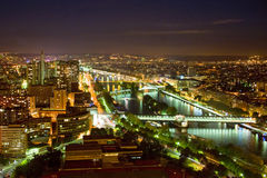 Paris with Seine River at night. Paris at night - view at the Bir Hakeim bridge on Sieine River with Île des Cygnes visible in the center Royalty Free Stock Photography