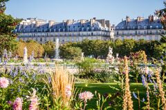 PARIS - September 10, 2019 : Aisles and pond of the Tuileries Garden in summer