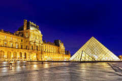 PARIS - SEPTEMBER 17. Glass pyramid and the Louvre museum on Sep Stock Photography